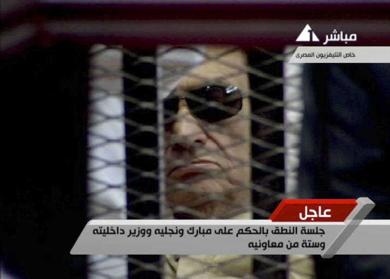 In this video image taken from Egyptian State Television, 84-year-old former Egyptian president Hosni Mubarak is seen in the defendant's cage as a judge reads the verdict in on charges of complicity in the killing of protesters during last year's uprising that forced him from power, in Cairo, Egypt, Saturday, June 2, 2012. (AP Photo/Egyptian State TV) EGYPT OUT