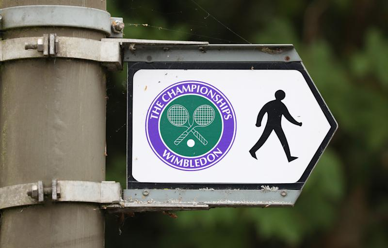 A road sign attached to a lamp post directs pedestrians to the All England Lawn Tennis and Croquet Club, Wimbledon, on what would have been the first day of the famous tennis tournament, which was cancelled this year due to the coronavirus threat. (Photo by Jonathan Brady/PA Images via Getty Images)