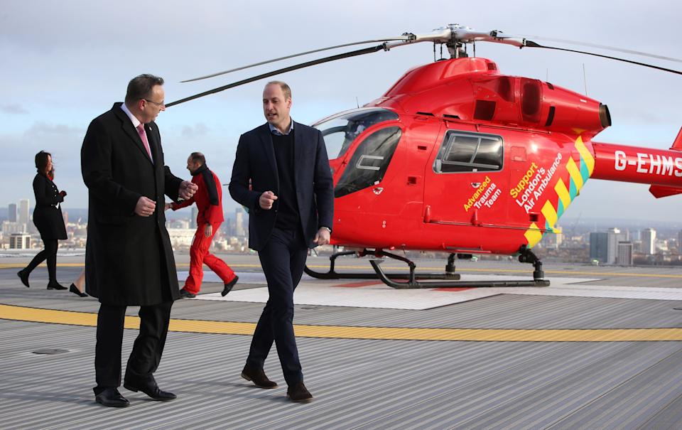 Britain's Prince William, Duke of Cambridge (R), walks across the helipad after arriving in a red London Air Ambulance at the Royal London Hospital in east London on January 9, 2019. - The Duke of Cambridge visited London's Air Ambulance to recognise the work that the organisation's first responders carry out delivering life-saving treatment across London. (Photo by Ian Vogler / POOL / AFP)        (Photo credit should read IAN VOGLER/AFP via Getty Images)