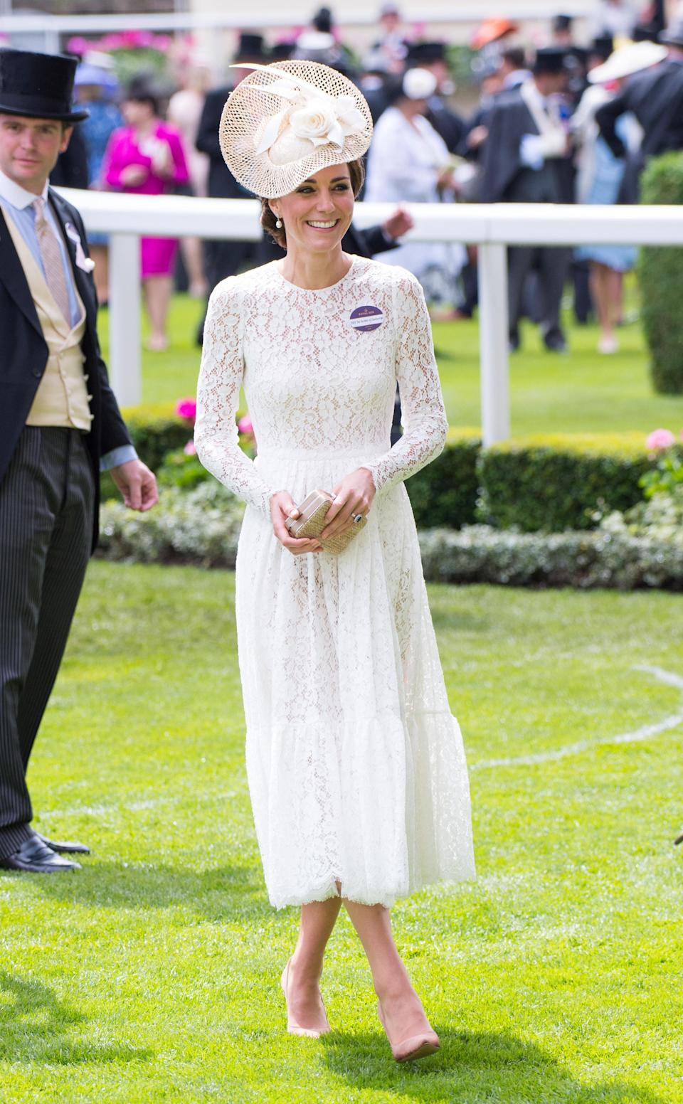 <p>For the first day of Royal Ascot 2017, the Duchess of Cambridge opted for a lace midi dress by Alexander McQueen. The look was reminiscent of a Dolce and Gabbana number she wore to the event. She teamed the dress with Gianvito Rossi heels. <em>[Photo: Getty]</em> </p>
