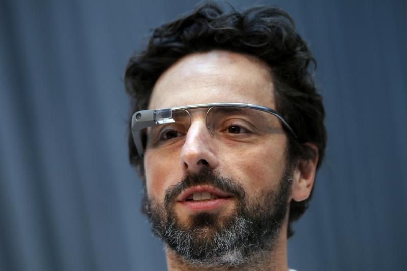 Google Inc. co-founder Sergey Brin looks on after the Life Sciences Breakthrough Prize announcement in San Francisco, California, in this February 20, 2013 file photo. On November 9, 2014, Brin, who previously never missed a high-profile opportunity to sport Google Glass, sauntered bare-faced into a Silicon Valley red-carpet event, telling a reporter he had left his pair in the car. To match Insight GOOGLE-GLASS/ REUTERS/Robert Galbraith/Files (UNITED STATES - Tags: SCIENCE TECHNOLOGY BUSINESS HEADSHOT PROFILE)