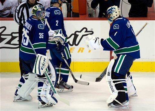 Vancouver Canucks' goalie Roberto Luongo, right, comes off the bench to replace goalie Cory Schneider after allowing five goals to the Anaheim Ducks during second period NHL hockey action in Vancouver on Saturday, Jan. 19, 2013. (AP Photo/The Canadian Press, Darryl Dyck)