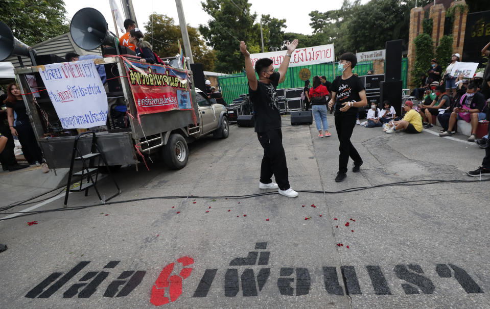 Pro-democracy activists gather outside remand prison, in which some of the activists are kept, in Bangkok, Thailand, Friday, Oct. 23, 2020. Thailand's government on Thursday canceled a state of emergency it had declared last week for Bangkok in a gesture offered by the embattled prime minister to cool student-led protests seeking democracy reforms. (AP Photo/Sakchai Lalit)