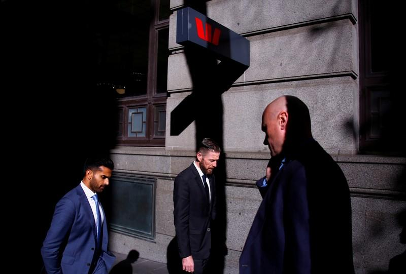 FILE PHOTO: Pedestrians walk past a branch of the Westpac Banking Corporation in central Sydney