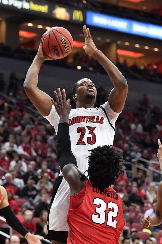 Louisville center Steven Enoch (23) shoots over the defense of Youngstown State guard Garrett Covington (32) during the second half of an NCAA college basketball game in Louisville, Ky., Sunday, Nov. 10, 2019. (AP Photo/Timothy D. Easley)