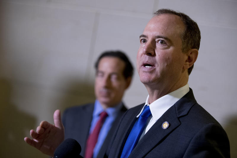 Rep. Adam Schiff, D-Calif., Chairman of the House Intelligence Committee, accompanied by Rep. Jamie Raskin, D-Md., left, speaks to reporters about the ongoing House impeachment inquiry into President Donald Trump on Capitol Hill in Washington, Monday, Nov. 4, 2019. (AP Photo/Andrew Harnik)