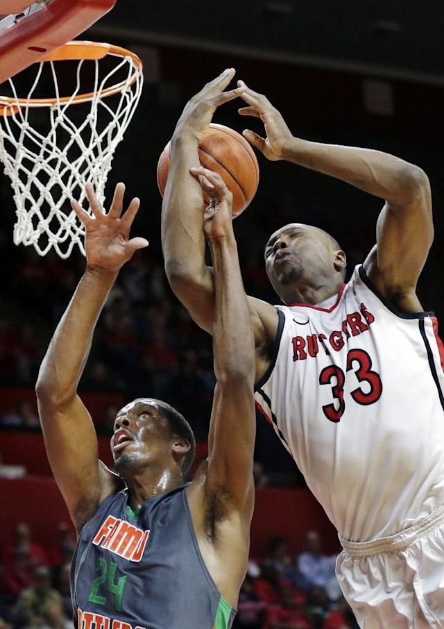 Rutgers forward Wally Judge (33) tries to grab the ball away from Florida A&M forward Bobby King during the first half of an NCAA college basketball game in Piscataway, N.J., Friday, Nov. 8, 2013. (AP Photo/Mel Evans)