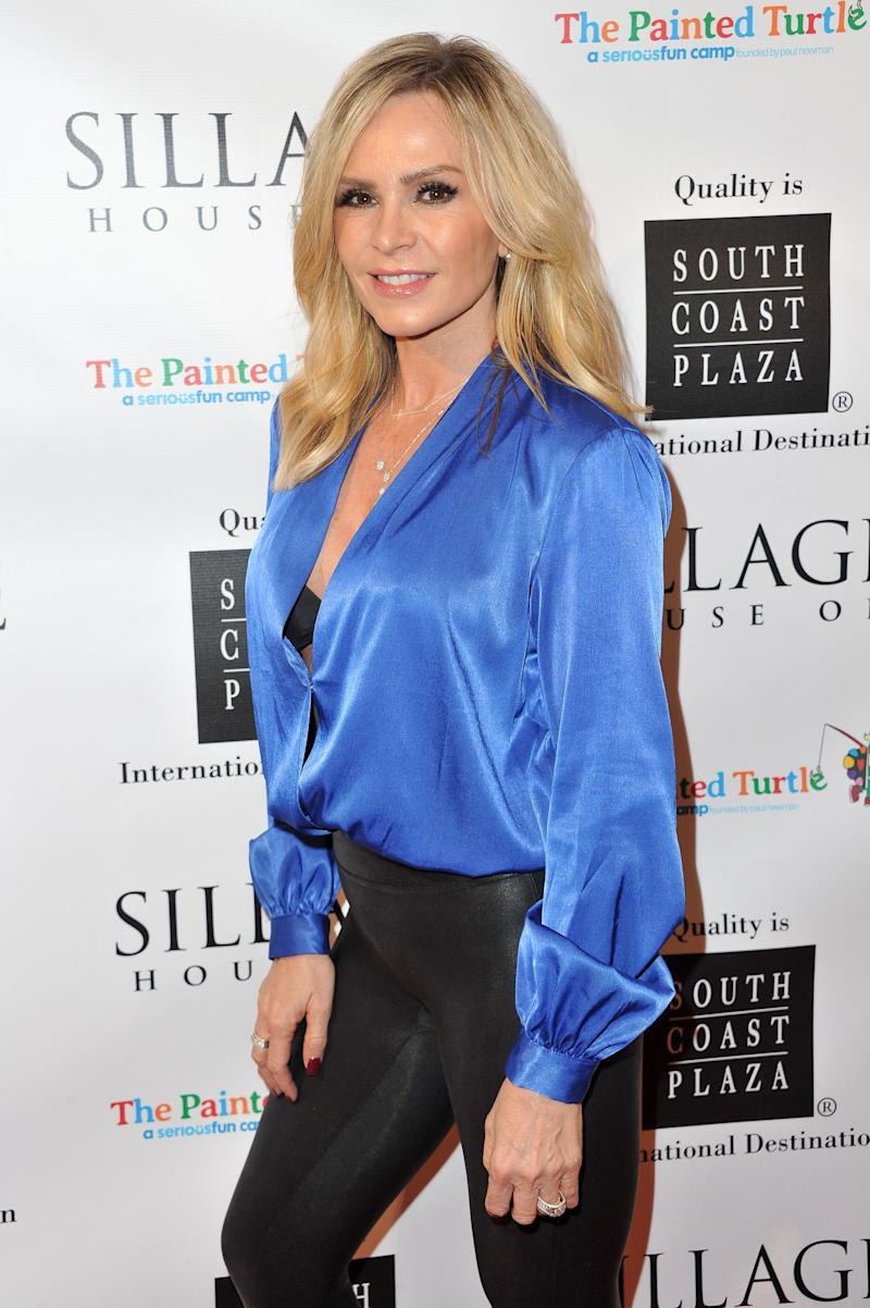 Black pant and blue long-sleeve shirt make the world go round and Tamra Judge looks breath-taking in it.
