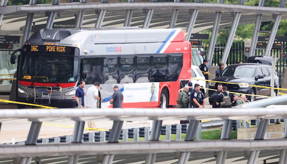 Police and officials work at the scene of a shooting in the Metro bus station outside the Pentagon in Arlington, Virginia. Source: AP