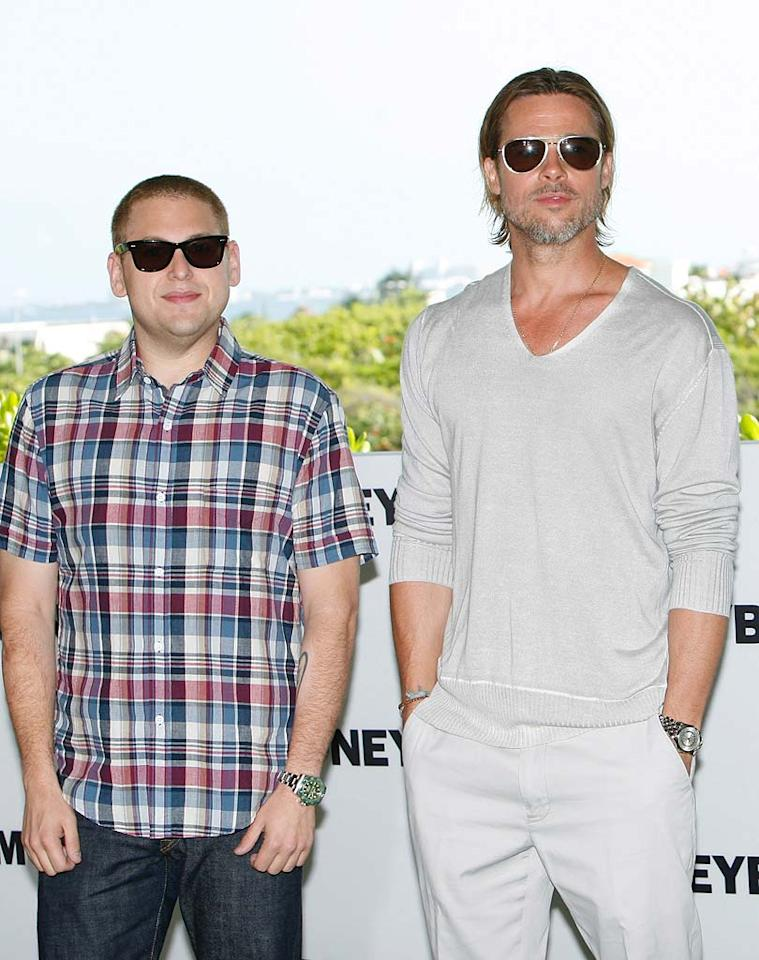"""According to <i>Star</i>, Brad Pitt is responsible for his """"Moneyball"""" co-star Jonah Hill's drastic weight loss. The mag says Pitt """"started lecturing Jonah about taking care of his body, eating healthy and getting regular exercise,"""" and even """"hired a personal trainer"""" for his co-star. For what Pitt used as incentive for Hill to lose weight, and how Hill plans to repay Pitt for his new slim bod, log on to <a href=""""http://www.gossipcop.com/jonah-hill-weight-loss-brad-pitt-moneyball-pounds-trainer/"""" target=""""new"""">Gossip Cop</a>. Handout/<a href=""""http://www.gettyimages.com/"""" target=""""new"""">GettyImages.com</a> - July 11, 2011"""