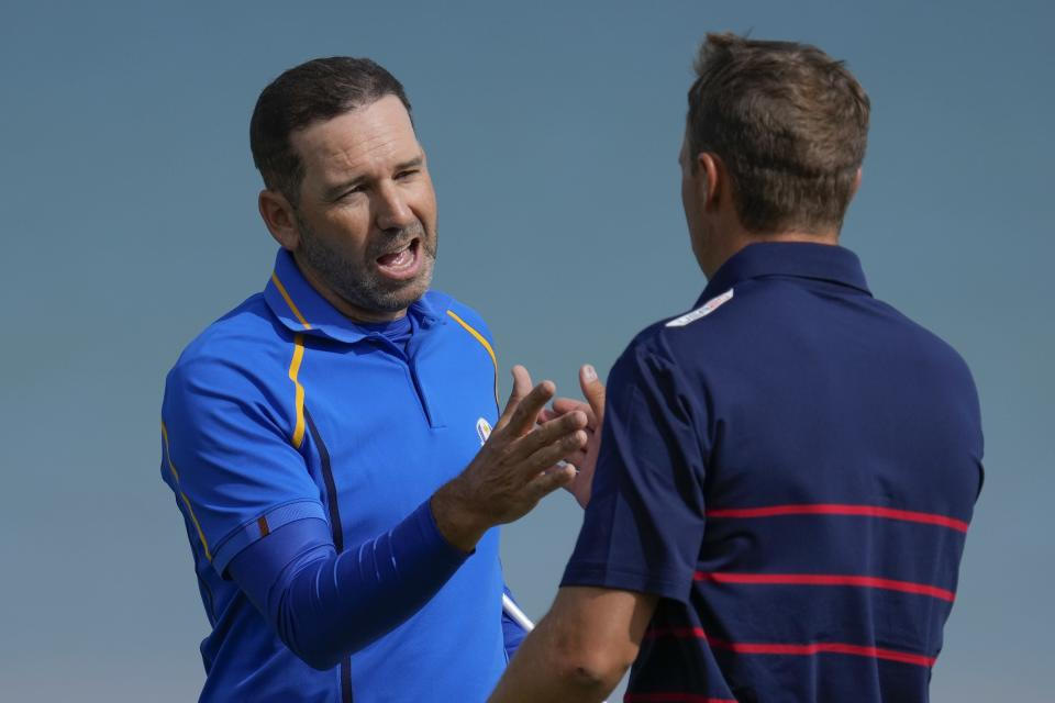 Team Europe's Sergio Garcia shakes hands with Team USA's Jordan Spieth after winning their foursome match the Ryder Cup at the Whistling Straits Golf Course Friday, Sept. 24, 2021, in Sheboygan, Wis. (AP Photo/Ashley Landis)