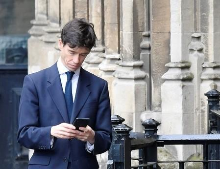 FILE PHOTO: Britain's Secretary of State for International Development Rory Stewart checks his phone outside Houses of Parliament in London