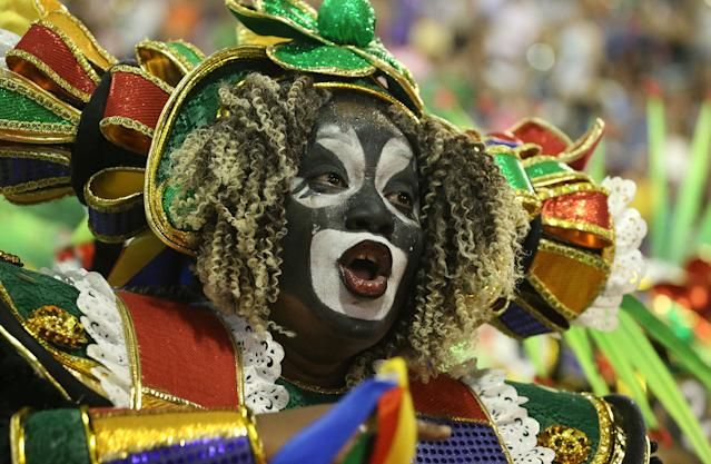 <p>A reveller from Grande Rio Samba school performs during the first night of the Carnival parade at the Sambadrome in Rio de Janeiro, Brazil, Feb. 12, 2018. (Photo: Ricardo Moraes/Reuters) </p>