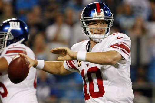 New York Giants quarterback Eli Manning (10) throws against the Carolina Panthers during the first quarter of an NFL football game in Charlotte, N.C., Thursday, Sept. 20, 2012. (AP Photo/Bob Leverone)