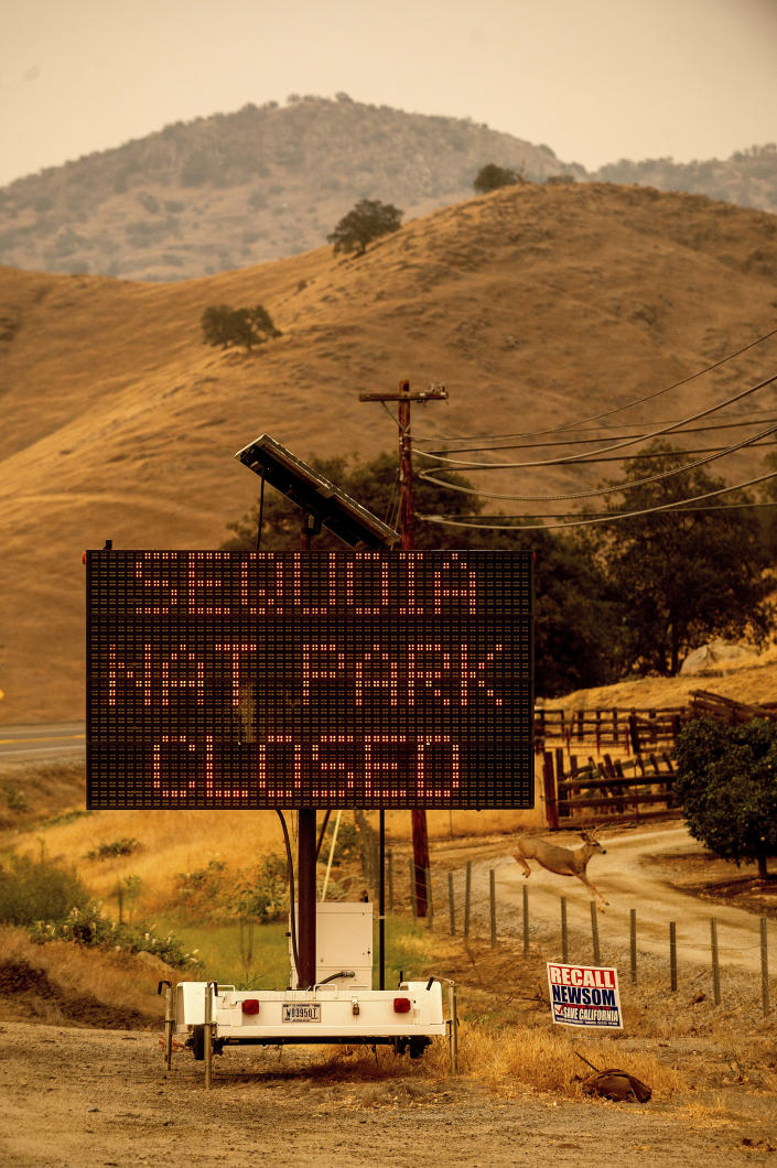 A sign announces the closure of Sequoia National Park, where the KNP Complex Fires are burning, Tuesday, Sept. 14, 2021, in Tulare County, Calif. Individually named the Colony and Paradise Fires, the blazes are burning near the Giant Forest, home to more than 2,000 giant sequoias. (AP Photo/Noah Berger)