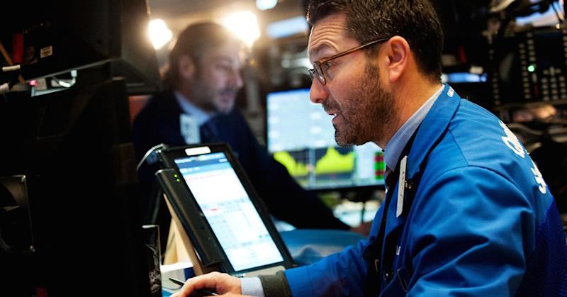 Dow falls triple digits amid Trump policy disappointment; financials lag