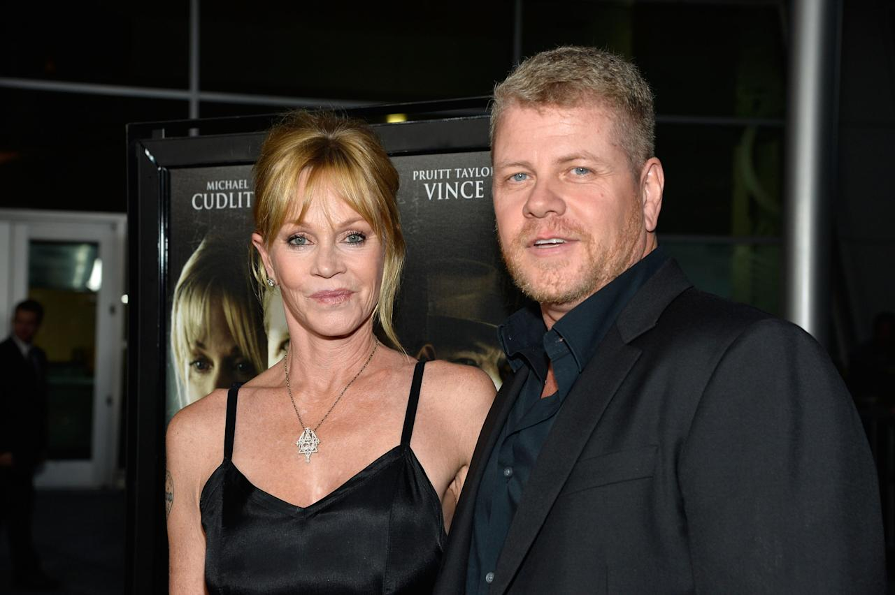 "HOLLYWOOD, CA - AUGUST 14: Actors Melanie Griffith and Michael Cudlitz arrive at the Premiere Of ""Dark Tourist"" at ArcLight Hollywood on August 14, 2013 in Hollywood, California. (Photo by Frazer Harrison/Getty Images)"