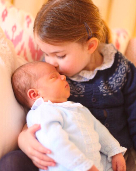 <p>Princess Charlotte gave her little brother a kiss for their debut photograph together. The Duchess of Cambridge was behind the camera and Kensington Palace shared the adorable snap on 6 May to mark Princess Charlotte's third birthday. <em>[Photo: Duchess of Cambridge/Instagram]</em> </p>