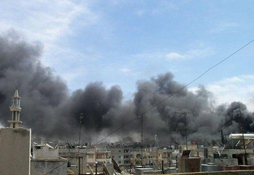 "A handout image released by the Syrian opposition's Shaam News Network shows smoke ascending from burning buildings in the area of al-Qusur in Homs province. French Foreign Minister Alain Juppe on Wednesday labelled the UN-backed peace plan for Syria ""seriously compromised"" and held out the threat of seeking military action to end the year-long crackdown"