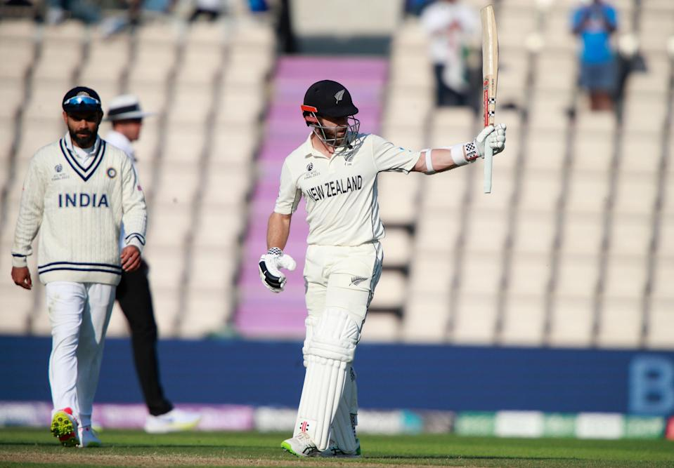 New Zealand's captain Kane Williamson raises his bat to celebrate scoring fifty runs during the sixth day of the World Test Championship final cricket match between New Zealand and India.