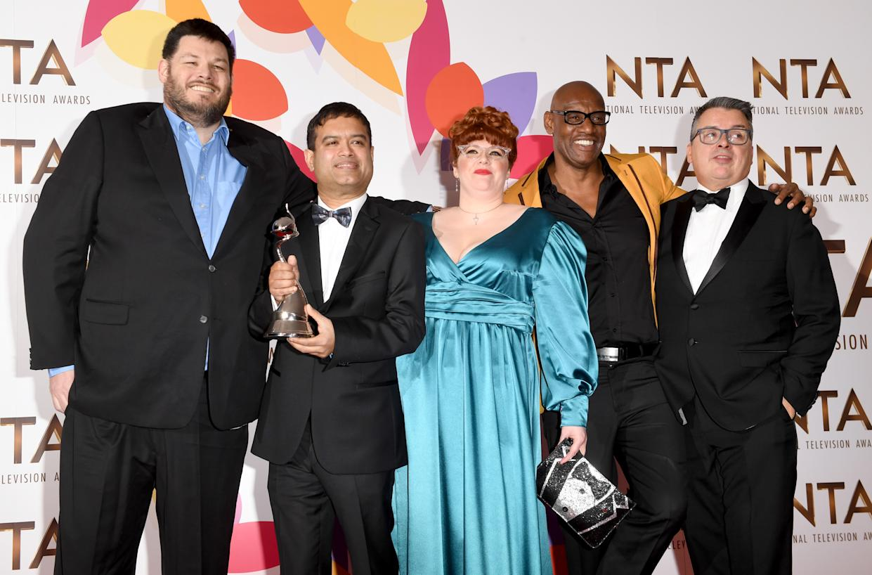 """LONDON, ENGLAND - JANUARY 22:  Mark Labbett, Paul Sinha, Jenny Ryan, Shaun Wallace and guest with the award for Quiz Show for """"The Chase"""" during the National Television Awards held at The O2 Arena on January 22, 2019 in London, England. (Photo by Stuart C. Wilson/Getty Images)"""