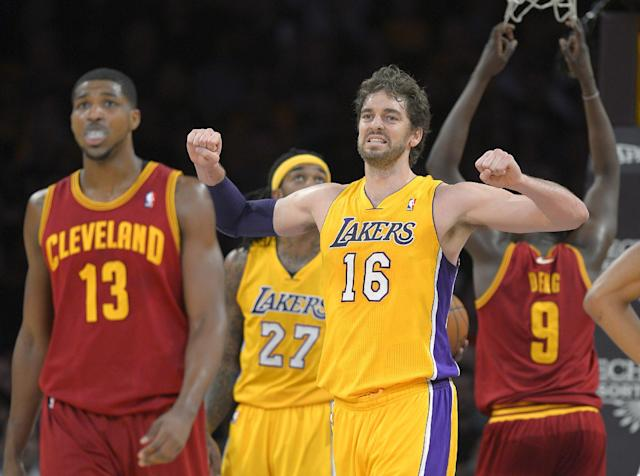 Los Angeles Lakers center Pau Gasol, of Spain, reacts after the Lakers turned over the ball, as Cleveland Cavaliers forward Tristan Thompson walks nearby during the first half of an NBA basketball game, Tuesday, Jan. 14, 2014, in Los Angeles. (AP Photo/Mark J. Terrill)