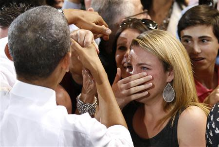 A woman cries while meeting U.S. President Barack Obama at the Coral Reef High School in Miami
