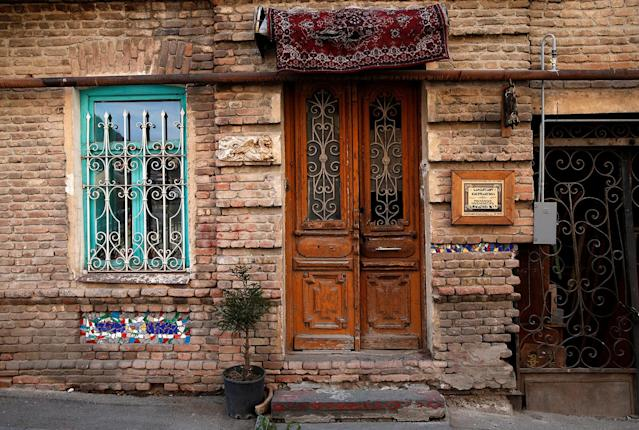 <p>A front door of an old house is seen in the old town, Tbilisi, Georgia, April 6, 2017. (Photo: David Mdzinarishvili/Reuters) </p>