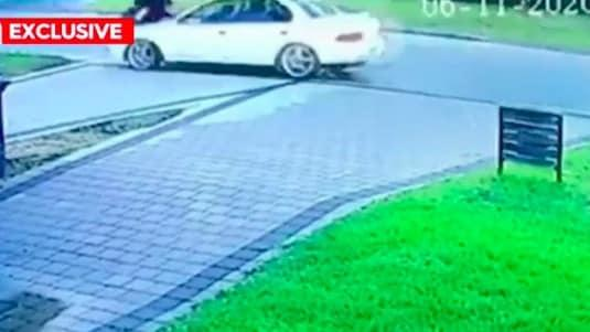 Video footage shows the teen walking when a white Subaru Impreza drives into her path