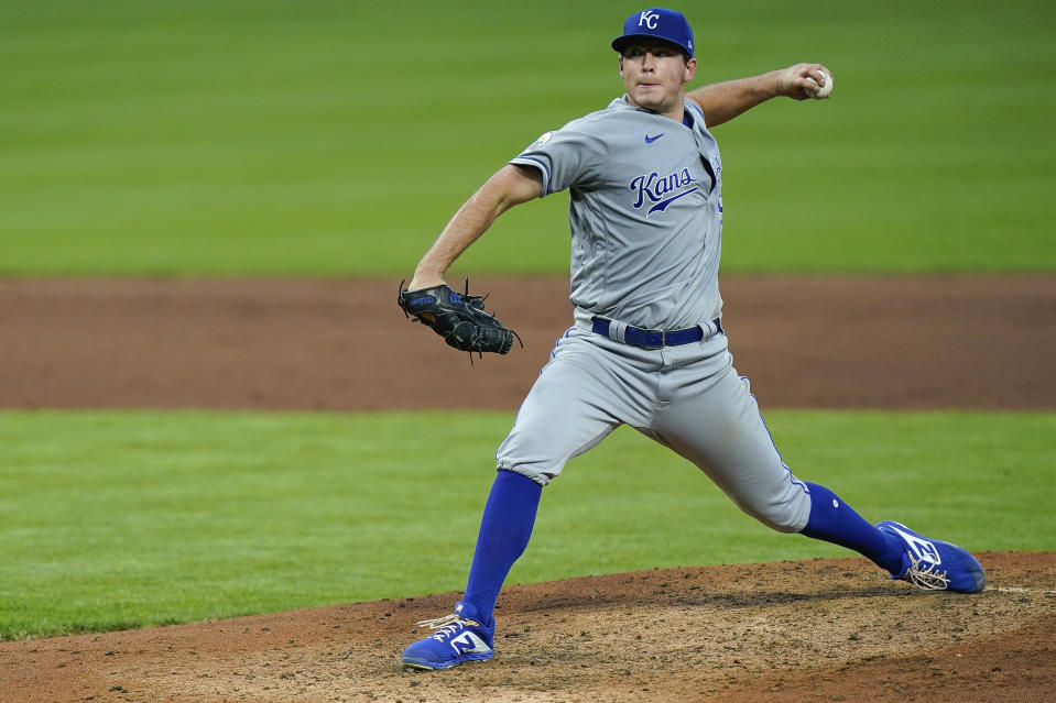 Kansas City Royals starting pitcher Kris Bubic throws during the fifth inning of the team;s baseball game against the Cincinnati Reds in Cincinnati, Tuesday, Aug. 11, 2020. (AP Photo/Bryan Woolston)