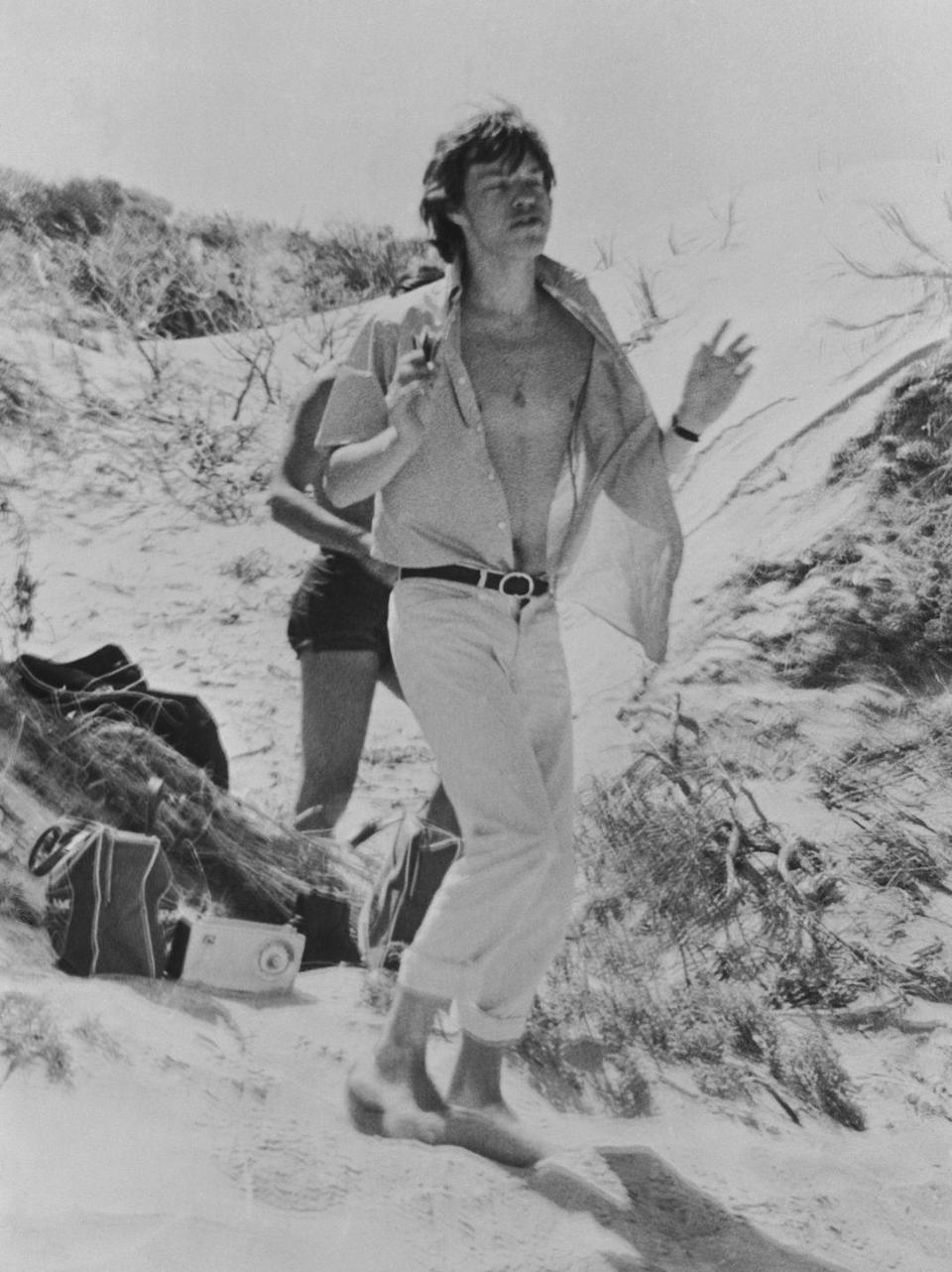 <p>Mick Jagger on an Australian beach in 1965 during a Rolling Stones tour. </p>
