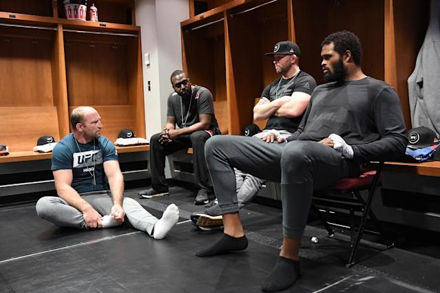 Maurice Greene (R) has added training at Colorado's Factory X gym to the coaching he receives from Brock Larson (far left). (Getty Images)