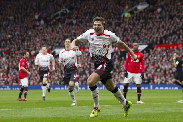 Liverpool's Steven Gerrard celebrates after scoring against Manchester United during their English Premier League soccer match at Old Trafford Stadium, Manchester, England, Sunday March 16, 2014. (AP Photo/Jon Super)