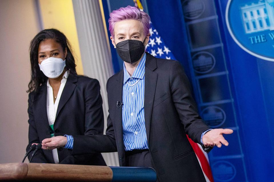 <p>Megan Rapinoe and Margaret Purce take the podium prior to Equal Pay Day in the State Dining Room of the White House on Wednesday in Washington, D.C.</p>