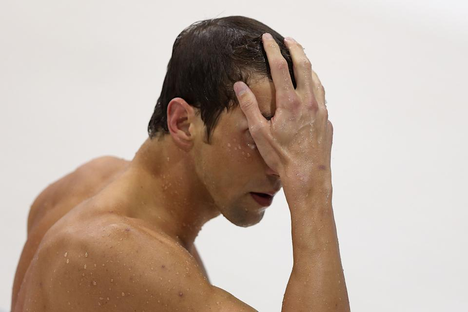 LONDON, ENGLAND - JULY 31: Michael Phelps of the United States leaves the pool after winning the silver in the Men's 200m Butterfly final on Day 4 of the London 2012 Olympic Games at the Aquatics Centre on July 31, 2012 in London, England. (Photo by Ezra Shaw/Getty Images)