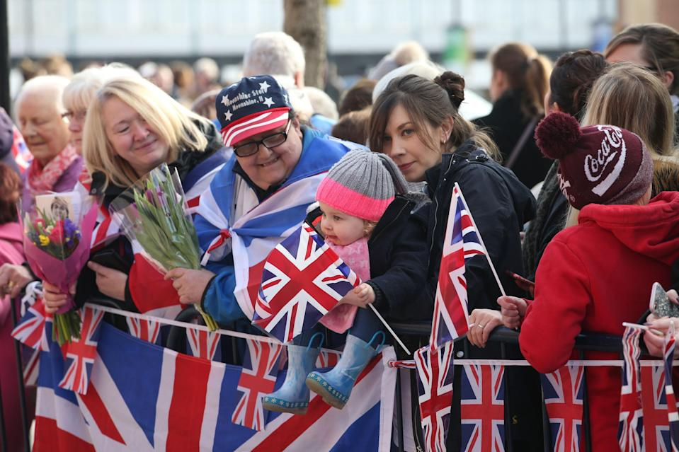 Patriotic crowds line the streets, waiting for a glimpse of the royals (PA Images)