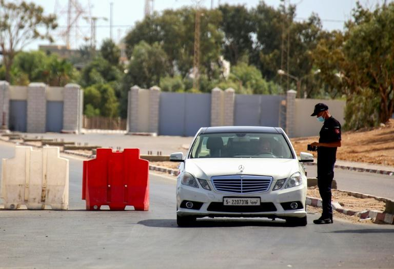 Libya closed its border with Tunisia in July following the deadly surge in cases in its northwestern neighbour but reopened it on Friday after the caseload eased (AFP/FATHI NASRI)