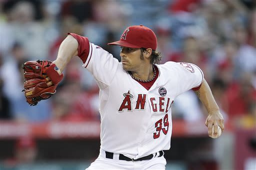 Los Angeles Angels starting pitcher C.J. Wilson throws during the first inning of a baseball game against the Boston Red Sox in Anaheim, Calif., Friday, July 5, 2013. (AP Photo/Jae C. Hong)