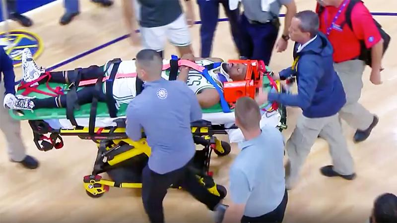 Pictured here, Kemba Walker is stretchered off court after suffering a serious head injury.
