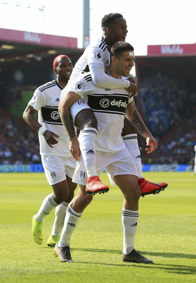 Fulham's Aleksandar Mitrovic celebrates scoring his side's first goal of the game during the English Premier League soccer match between Bournemouth and Fulham at the Vitality Stadium, Bournemouth England. Saturday, April 20, 2019. (Mark Kerton/PA via AP)