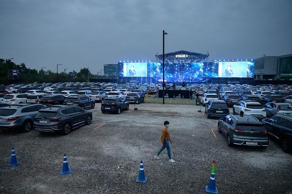 People attend a drive-in concert in a parking lot in Goyang amid social gathering concerns due to the covid-19 novel coronavirus.