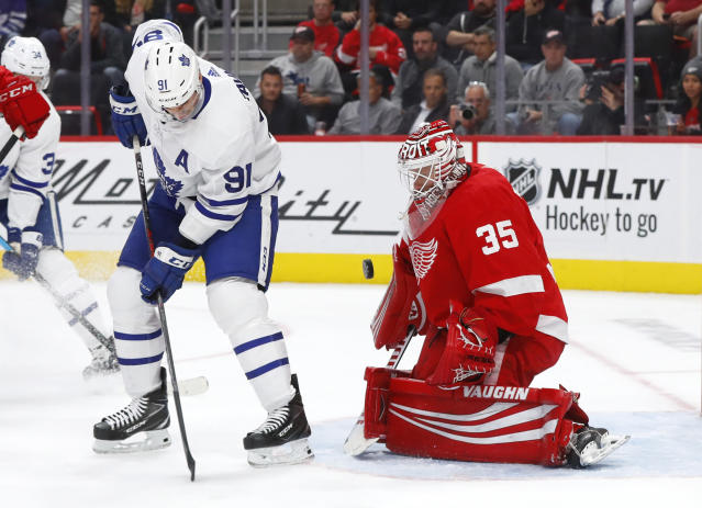 Detroit Red Wings goaltender Jimmy Howard (35) stops a deflection by Toronto Maple Leafs center John Tavares (91) during the first period of an NHL hockey game Thursday, Oct. 11, 2018, in Detroit. (AP Photo/Paul Sancya)