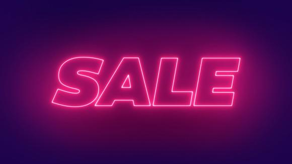"""A neon sign with the word """"sale."""""""