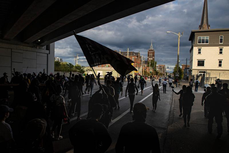 Protesters walk under an overpass as they march through downtown Louisville and into Nulu on Friday evening. Sept. 25, 2020