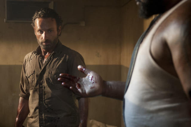 "Rick Grimes (Andrew Lincoln) and Big Tiny (Theodus Crane) in ""The Walking Dead"" episode, ""Sick."""