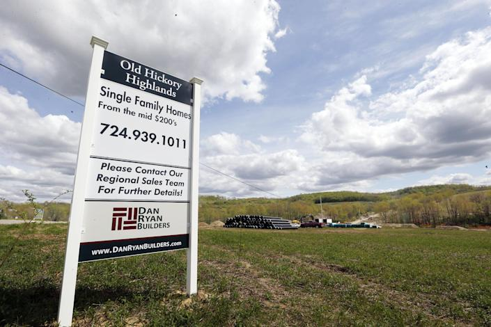 In this Monday, May 6, 2013, photo, construction is underway on the infrastructure of a multi-acre housing development in Zelienople, Pa. The National Association of Home Builders reports on its index of confidence among U.S. homebuilders for May on Wednesday, May 15, 2013. (AP Photo/Keith Srakocic)