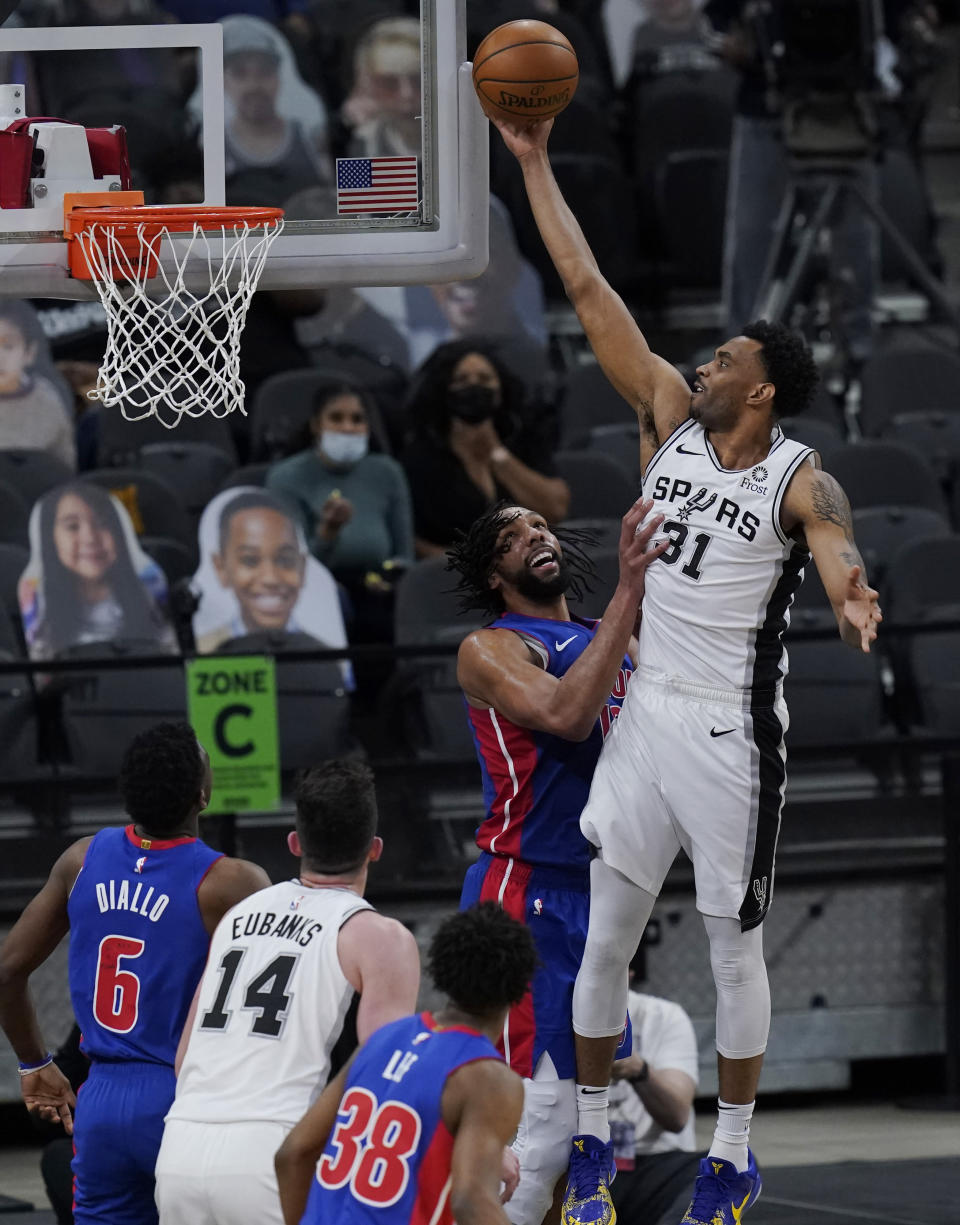 San Antonio Spurs forward Keita Bates-Diop (31) scores over Detroit Pistons center Jahlil Okafor (13) during the second half of an NBA basketball game in San Antonio, Thursday, April 22, 2021. (AP Photo/Eric Gay)
