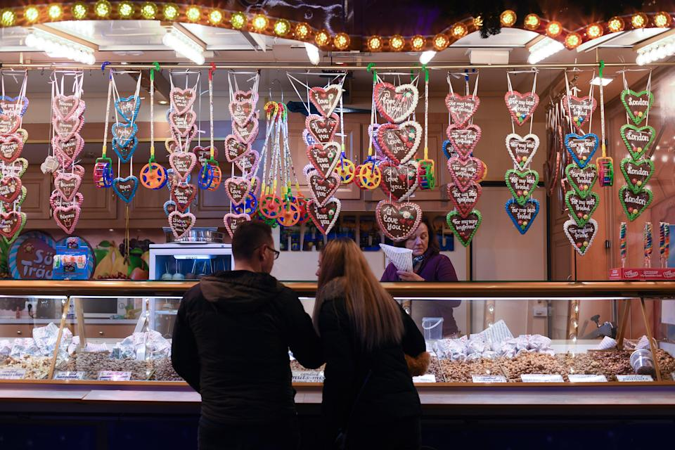 Visitors at a snack stall at Winter Wonderland in Hyde Park, London (PA)