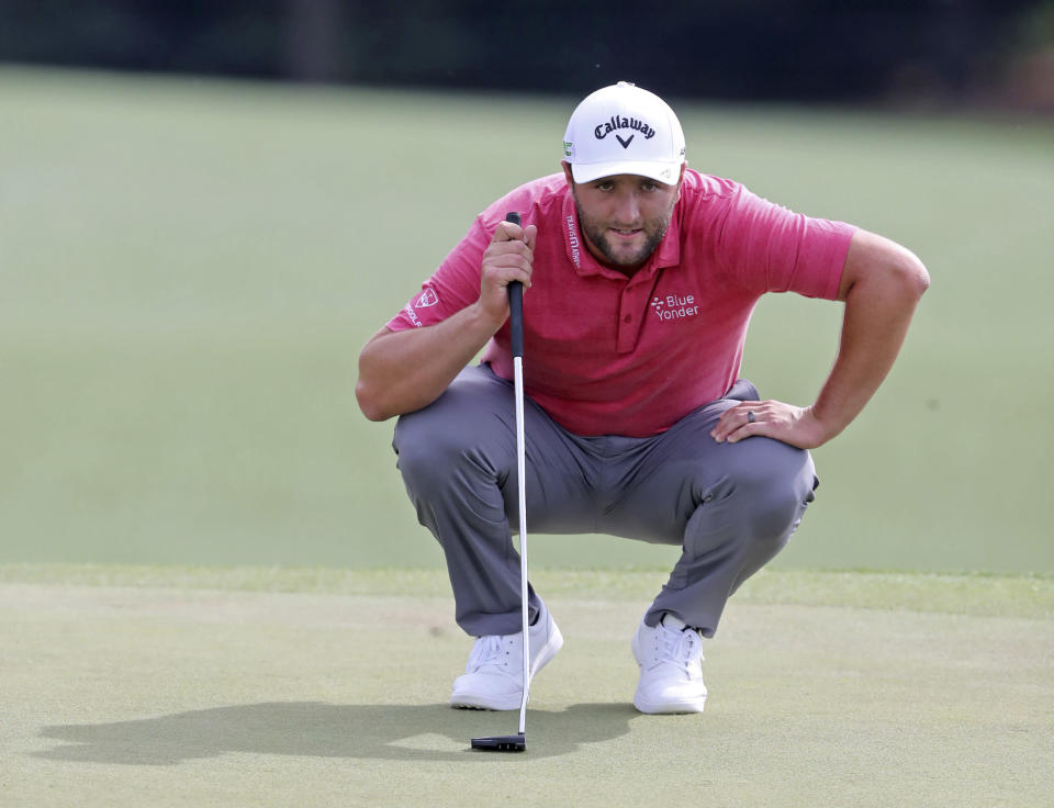 Jon Rahm looks over his putt on the 18th green during the final round of the Masters golf tournament at Augusta National, Sunday, April 11, 2021, in Augusta, Ga. (Curtis Compton/Atlanta Journal-Constitution via AP)