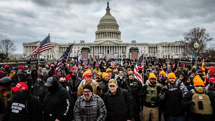 Pro-Trump protesters gather in front of the U.S. Capitol Building on Jan. 6, a mob that eventually stormed the Capitol, breaking windows and clashing with police officers, killine one. (Photo by Jon Cherry/Getty Images)